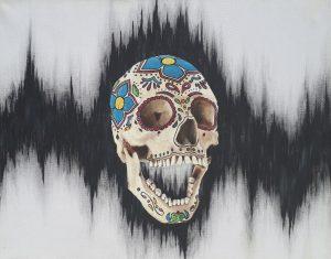 candy skull against black static
