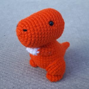 crocheted orange dinosaur