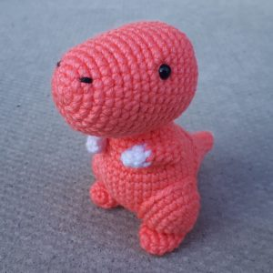 Crocheted pink Dinosaur